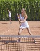 Two athletes on tennis court — Stock Photo