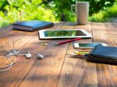 Wood desk and electronic gadgets — Stock Photo