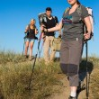 Family of hikers walks on clay path — Stock Photo #77066677