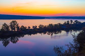Amazing orange dawn on blue lake — Stock Photo