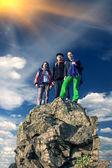 Group of climbers on sharp summit — Stock Photo