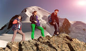 Group of climbers on alpine background — Stock Photo
