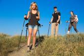 Hiking family on trail — Stock Photo