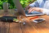 Man arms typing on keyboard at natural hardwood desk — Stock Photo