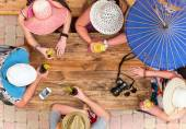 Company of friends different sex sitting at street cafe — Stock Photo