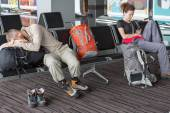 Passengers waiting for the air flight at airport terminal — Stock Photo