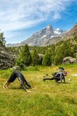 Young women doing morning fitness in mountain landscape — Stock Photo