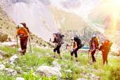 Group of people walking on trail — Stock Photo