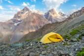Yellow tent on mountain landscape — Stock Photo