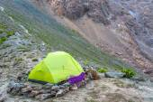 Green camping tent in mountains — Stock Photo