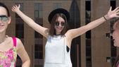 Joyful cute girl with arms raised — Stock Photo
