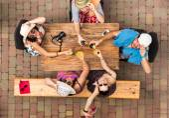 Joyful friends at street cafe — Stock Photo