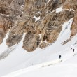 Climbers Linked with Protection Rope Ascending Glacier — Zdjęcie stockowe #83126140