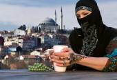 Middle Eastern Woman at Cafe Terrace — Stock Photo