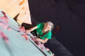 Aged Woman Climbing Wall — Stock Photo