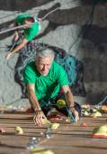 Smiling Mature Man on Extreme Climbing Wall — Стоковое фото
