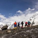 Mountaineers Walking Across Large Glacier — Stock Photo #85442832