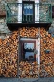 Woodpile and window of a typical chalet in italian alps — Fotografia Stock