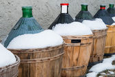 Wine's carboys covered by snow — Stock Photo