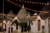Alberobello trullo at night decorated with hundreds of little li — Stock Photo