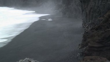 The cliffs and Volcanic sand — Stock Video