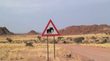 Elephant roadside sign in Africa — Stockvideo