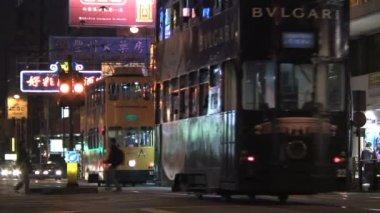 Trams on a busy street at night — Vidéo