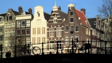 Dutch cyclists in Amsterdam — Stock Video