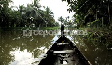 Canoeing by local people on backwaters — Stock Video