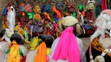 Masked dancers watching a dance festival — Stock Video