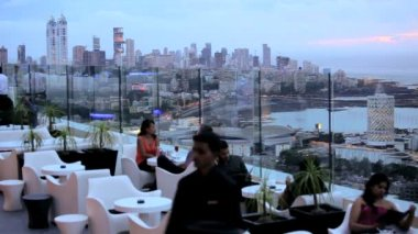 Rooftop bar where people are relaxing — Vidéo