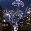 Christmas lights and London buses — Stock Video #62043085