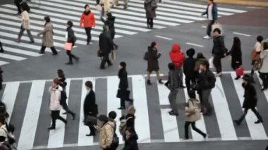 Pedestrians crossing crosswalk — Stock Video