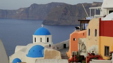 Domed white washed churches of Oia at Sunset Greece — Stock Video