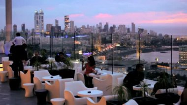 Rooftop bar where people are relaxing — Stockvideo