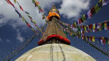 Prayer flags flying from the  Boudhanath Stupa — Stock Video