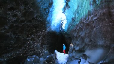 Male figure in glacier Ice Cave — ストックビデオ