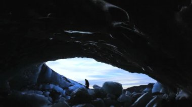 Male figure in glacier Ice Cave — Stockvideo