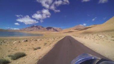 Motorbike motion barren landscape — Stock Video