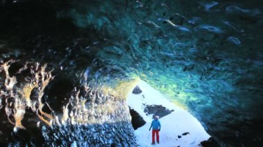 Male figure walking nr glacier Ice Cave — ストックビデオ