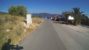 Bicycle motion ride to habour — Stockvideo