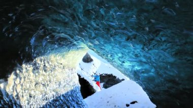 Male figure climbing nr glacier Ice Cave — Video Stock