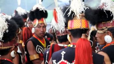 Chang tribesmen dressed in traditional costume and dancing at the Hornbill festival — Stock Video