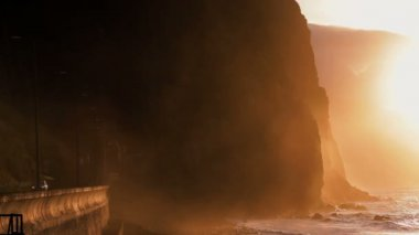 Road tunnel through Rocky cliffs at sunset — Stockvideo