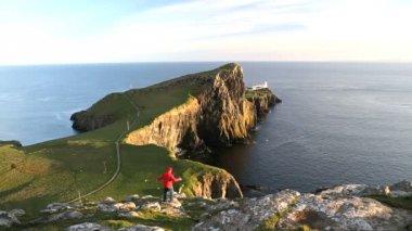Walker achieving Neist lighthouse — Stock Video