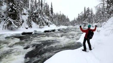 Male walker wearing snow shoes — Stock Video