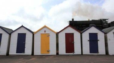 Steam Train passing Beach Huts, UK — Stock Video