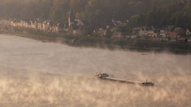 Commercial barge traveling through the early morning mist — Stock Video
