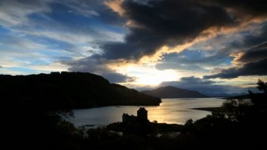 Scotland Eilean Donan Castle Loch Duich Highlands sunset coast — Stock Video