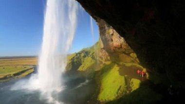 Iceland Seljalandsfoss Waterfall people mist travel tourist — Stock Video